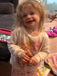 Little girl covered in orange marker