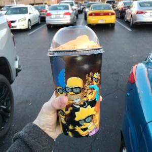 The Simpsons Kwik-E-Mart squishee orange flavor plastic cup