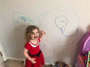 Toddler drawing on bedroom wall