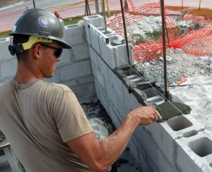 US sailor laying bricks United States maybe navy