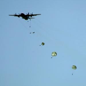 U.s. Navy plane sailors falling down with parachutes