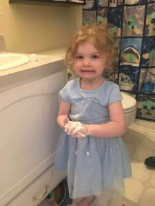 Toddler washing hands with Toothpaste