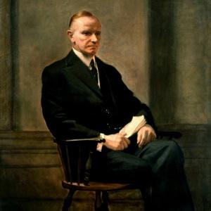 Calvin Coolidge sitting on chair