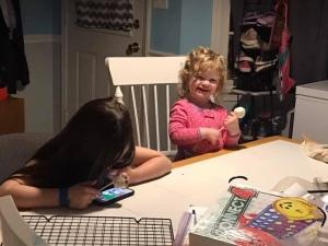 Little girls making cake pops