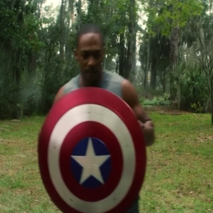 Sam Wilson holding captain America shield The Falcon and the Winter Soldier Disney+