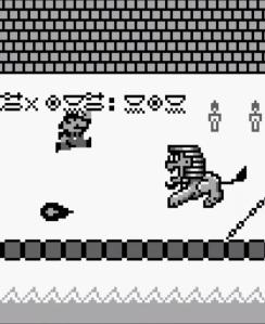 Mario jumping over fireball King Totomesu boss battle Super Mario Land Nintendo Gameboy