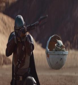 Mando protecting Grogu from sand people The Mandalorian
