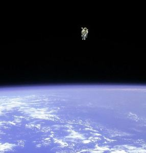 Astronaut hovering above space