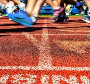 Runners running on track