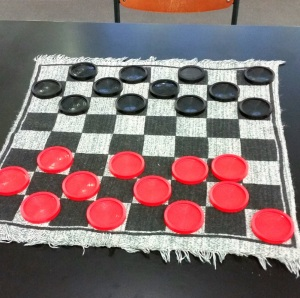 Cloth board For a checkers game