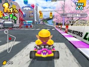 Wario driving Mario Kart Arcade GP Namco Nintendo