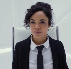 Agent M black suit and tie Men in Black international Tessa Thompson Chris Hemsworth
