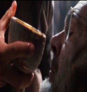 Henry Jones drinks from the cup Indiana Jones and the Last Crusade