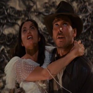 Marion Ravenwood and Indiana Jones surrounded by snakes Indiana Jones raiders of the Lost ark