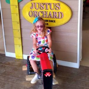 Little girl having fun Justus Orchard Hendersonville NC