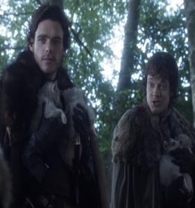 Theon Greyjoy holding direwolf puppies Game of Thrones HBO
