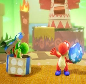Red Yoshi holding blue Dream Gem Tin-Can Condor Yoshi's Crafted World Nintendo Switch